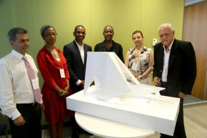 "Memorial designer Rodney Leon (standing, third from left) along side judges next to model of the ""Ark of Return,"" the winning design for the United Nations Permanent Memorial in Honor of the Victims of Slavery and the Transatlantic Slave Trade. Photo: DPI / the U.N."