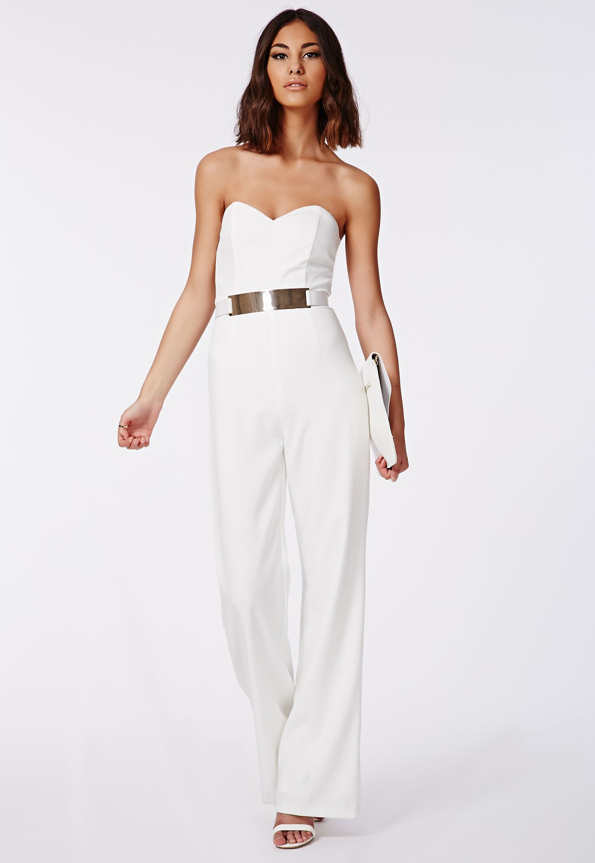 A hit of gold enhances the sleek lines of this jumpsuit.