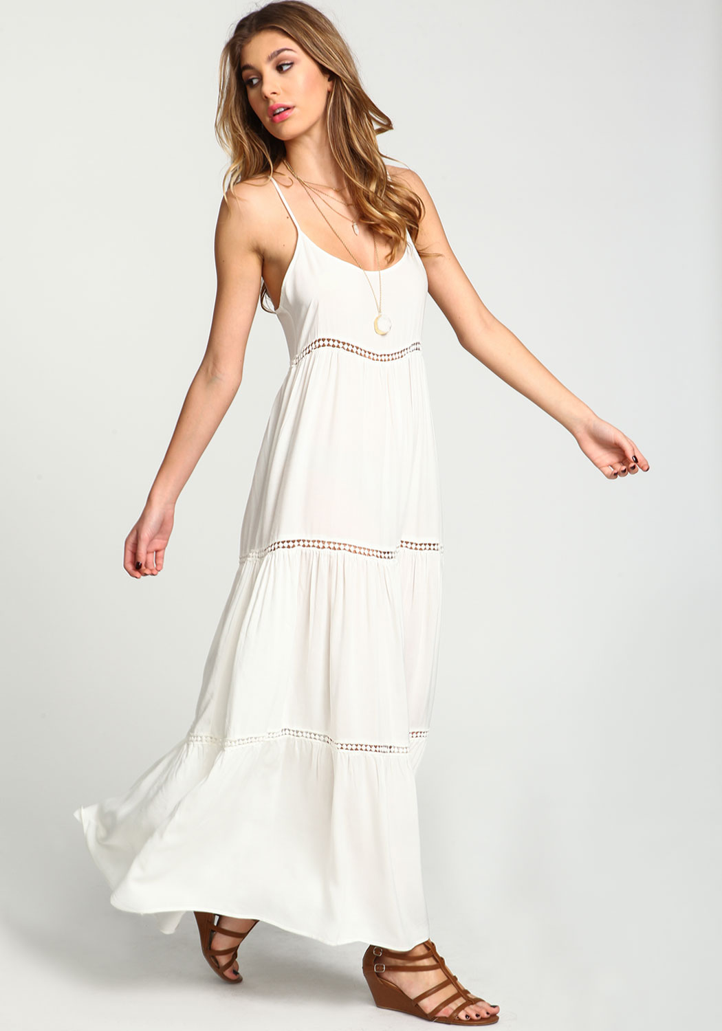 A flowing white maxi dress designed for movement and flair.
