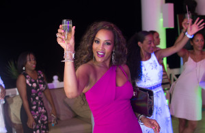 Glass raised in good cheer, Vivica A. Fox shows us what it means to have a good time.