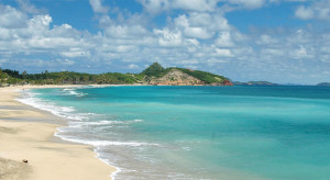 Azure waters lap sandy shores on the beautiful island of Grenada.